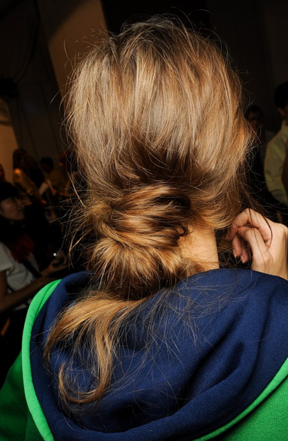 A few auburn highlights sprinkled throughout the bottom half of hair will show off its movement and give it added depth. A messy low bun is always the way to go for a long, hot day. The messier it gets, the better it looks.