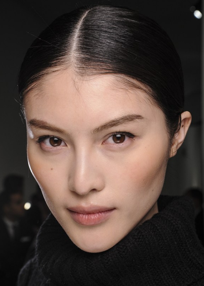 Ultra dark hair always looks beautiful slicked back with shine serum. Take it the next step with a sharp middle part.